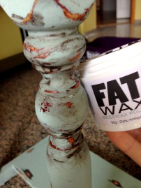 Applying dark FAT wax to the legs