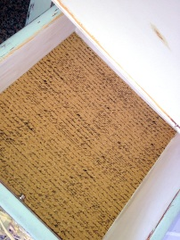 Cork drawer lining printed with script